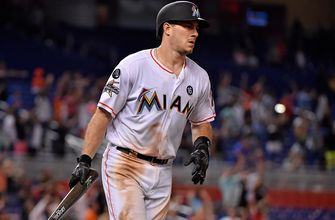 Marlins, catcher J.T. Realmuto go into arbitration to determine 2018 salary