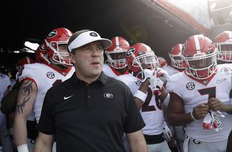 The Latest: Georgia, Ohio St vying for top signing day class